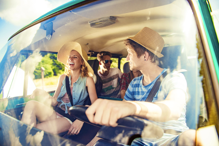 45742435 - beautiful young people on a road trip on a summers day