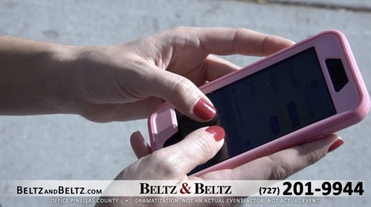 beltz and beltz tv commercial with person holding pink phone