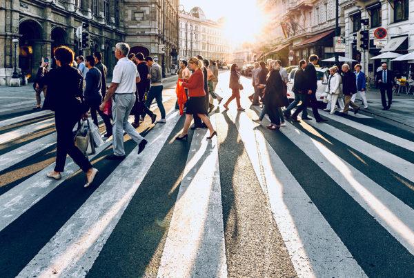 pedestrians in crosswalk in busy city