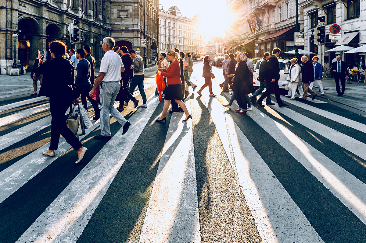 pedestrians in crosswalk in busy city