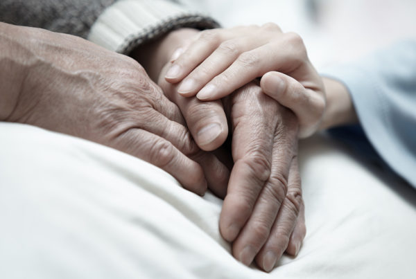 close up of elderly person's hands at an assisted living facility