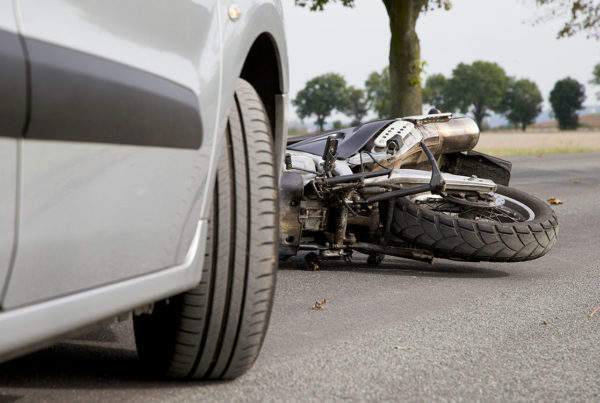 auto accident between a car and motorcycle