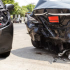two black sedan cars with damage after an auto accident