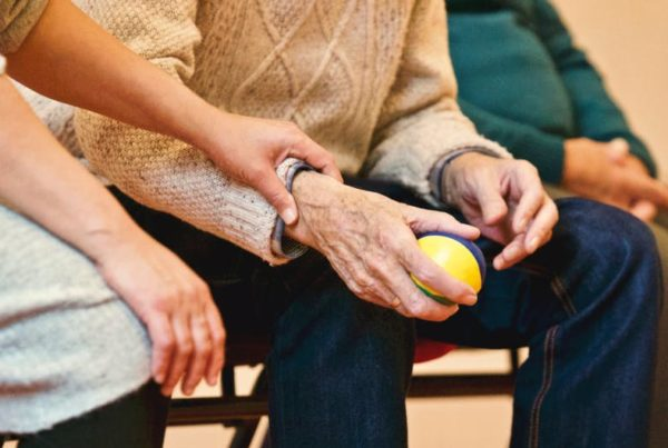 closup of eldery person's hands in a nursing home