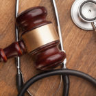 gavel and stethoscope sitting on a desk