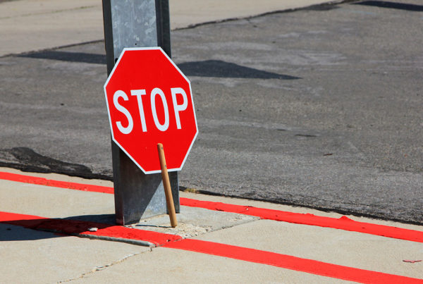 stop sign leaning against pose for crossing guard injured by pedestrian accident