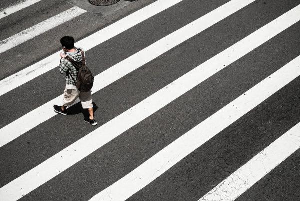 man crossing street pedestrian accident