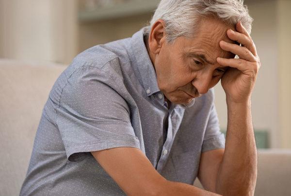 elderly man upset sad nursing home abuse