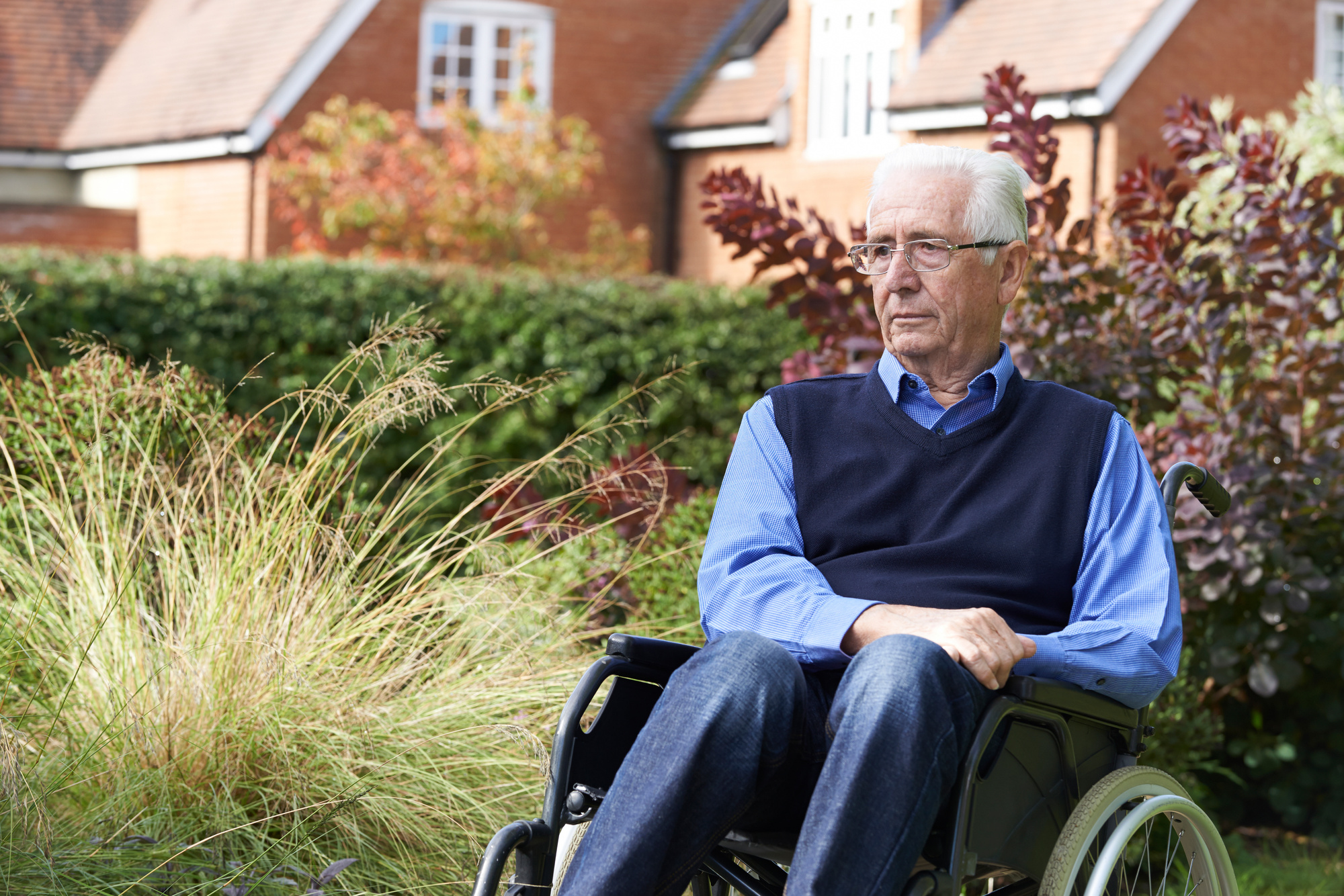 elderly man in wheelchair outside alone sad nursing home abuse
