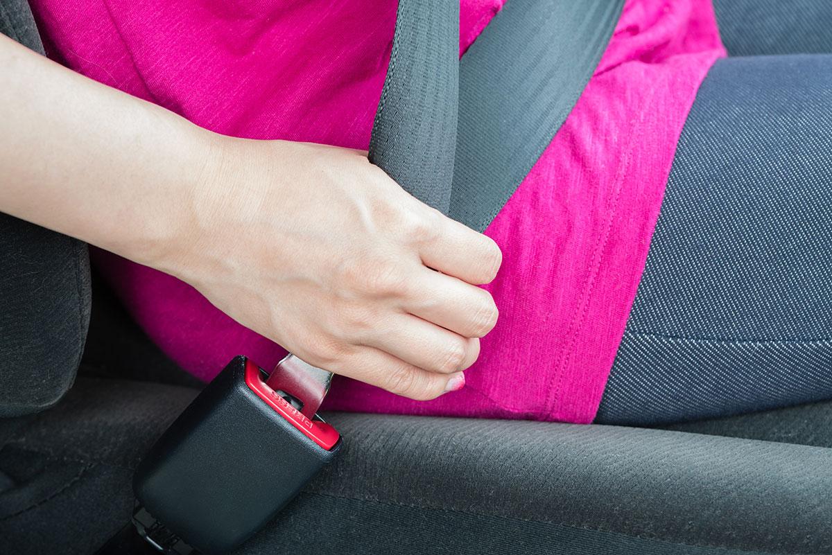 woman buckling seatbelt