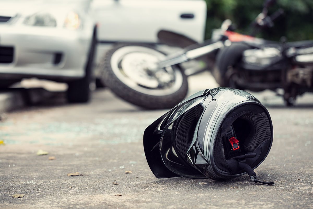 motorcycle helmet laying on ground after motorcycle crash