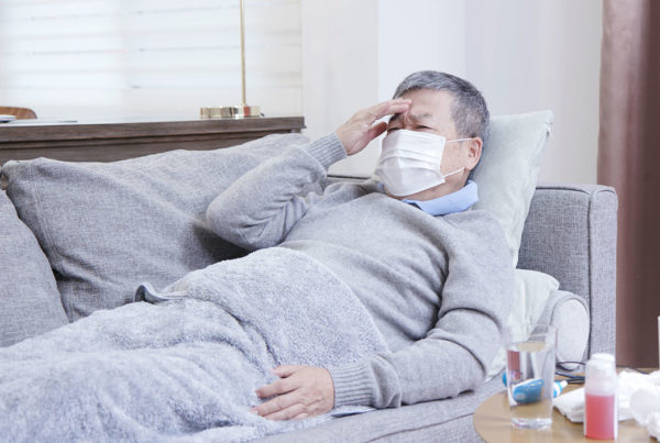 elderly man in nursing home wearing mask COVIS-19 Coronavirus