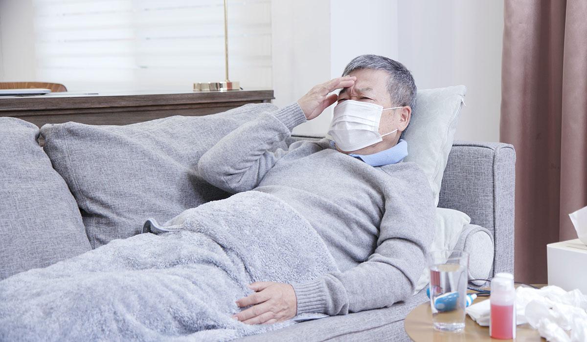 elderly man in nursing home wearing mask COVIS-19 Coronavirus