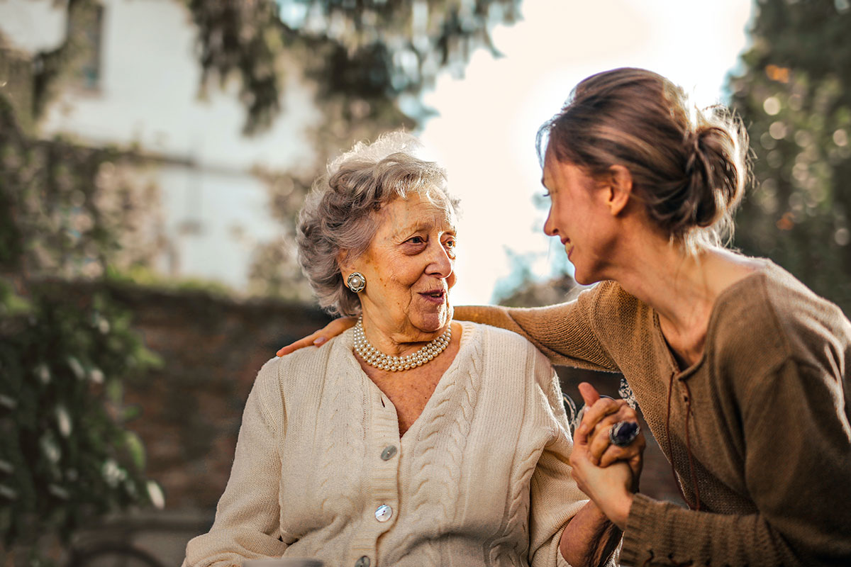 woman visiting her mother in a nursing home